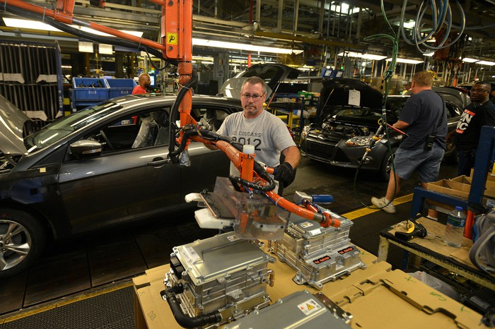 Workers assemble Ford Focuses on the assembly line at Ford Michigan Assembly Plant in Wayne, Michigan, in this 2013 file photo.
