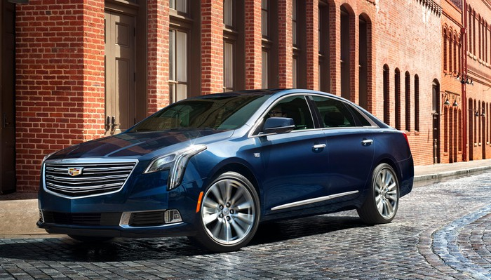 A dark blue 2018 Cadillac XTS on a city street