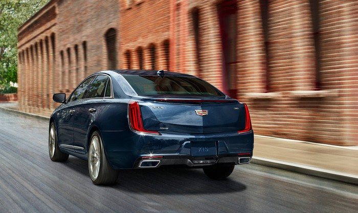 The 2018 Cadillac XTS, viewed from the rear on a city street