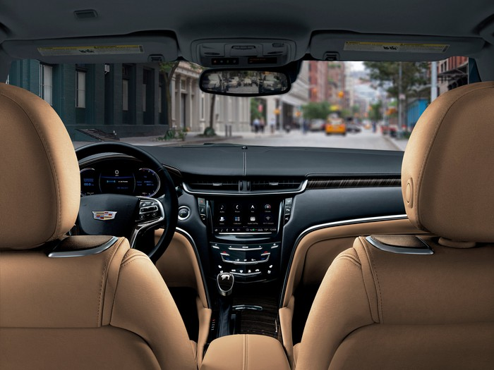 The 2018 Cadillac XTS's dash, viewed from the rear seat