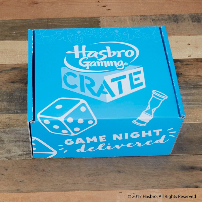"""A blue box labeled Hasbro Gaming Crate -- Game Night delivered."""""""