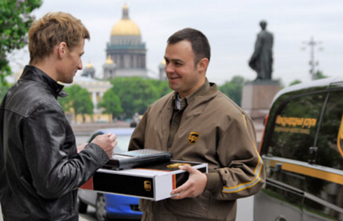 A customer signing for a UPS package.