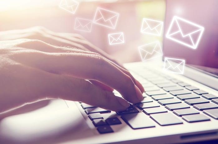 A man types e-mail.