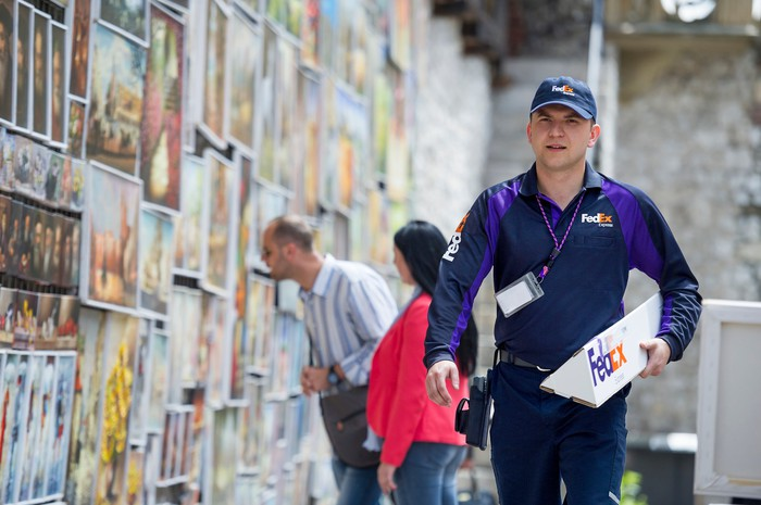A FedEx worker making a delivery