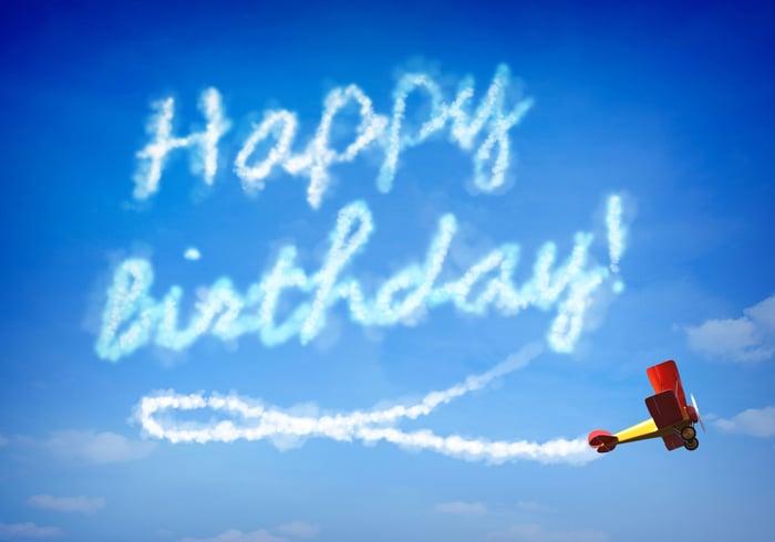 "A prop plane skywriting ""Happy Birthday!"""