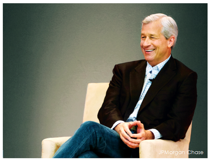 Jamie Dimon smiling and sitting in a chair.