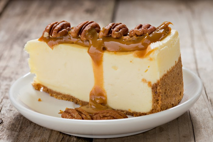 Cheesecake with walnuts and caramel on top