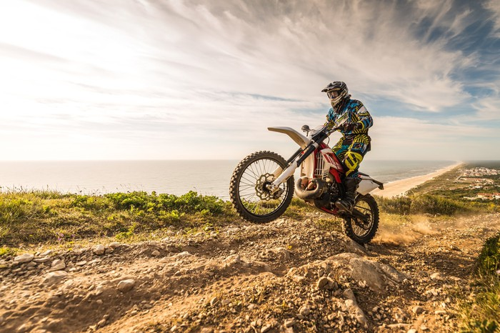 Enduro motorcycle rider on a dirt track.