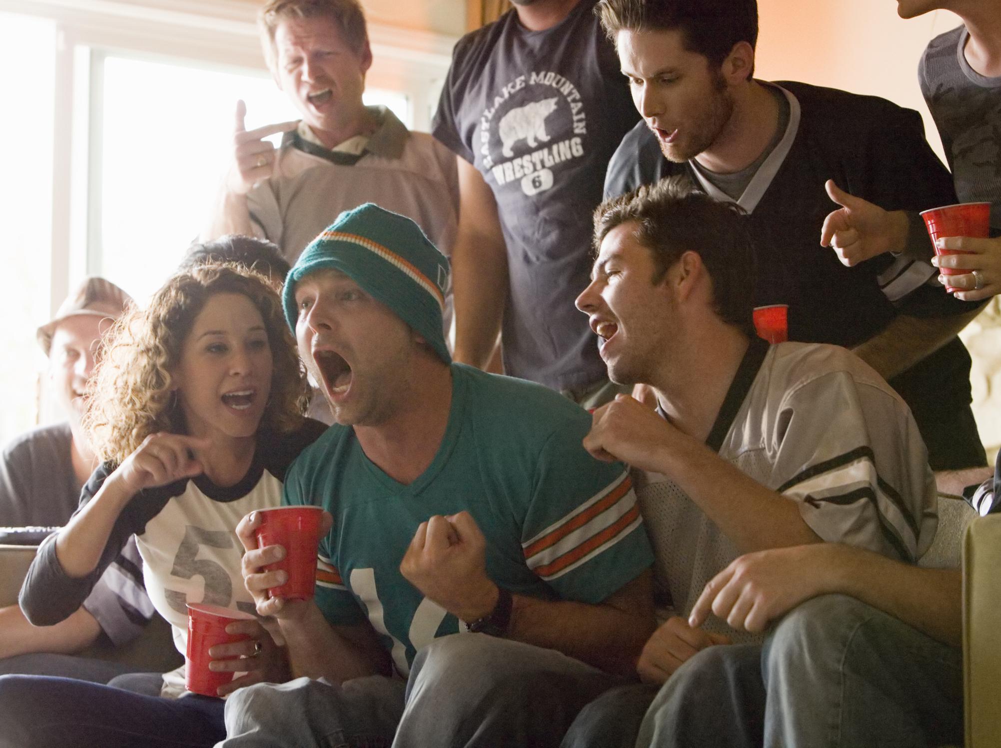 Friends watch football