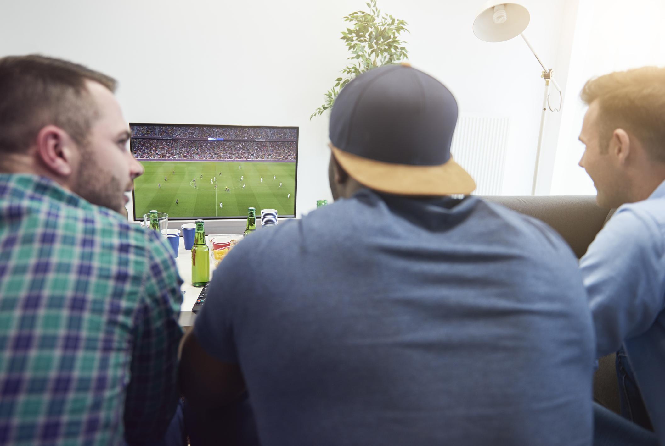 Friends watch a football game
