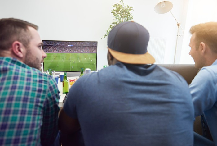 Friends watch a football game