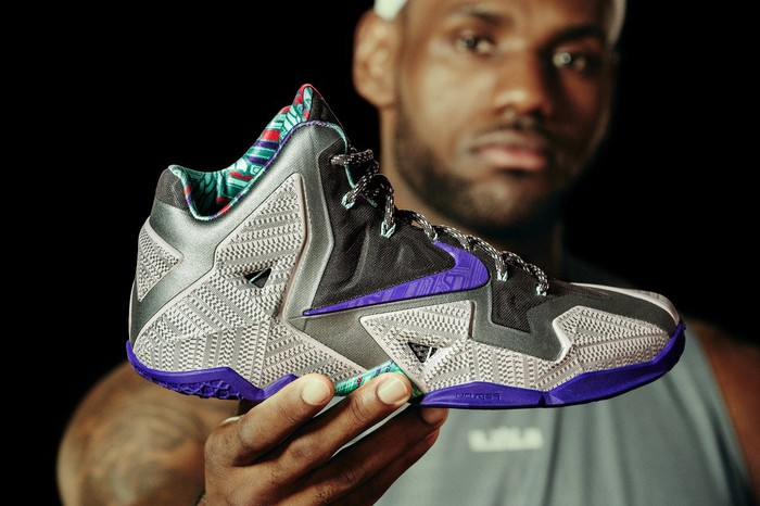 LeBron James holding his latest shoe design.