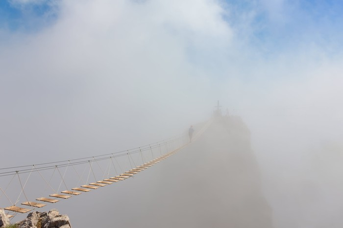 A bridge disappearing into mist