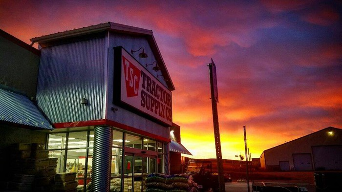 Tractor Supply storefront at sunset.