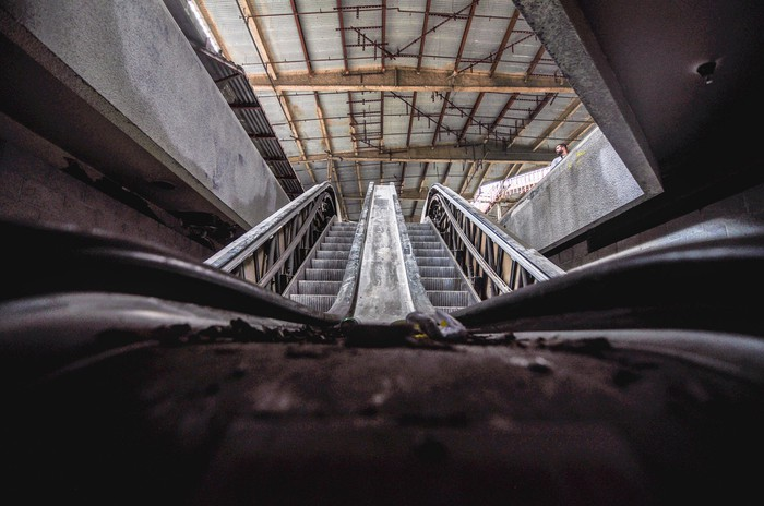A view from the bottom on an escelator in an abandoned mall.