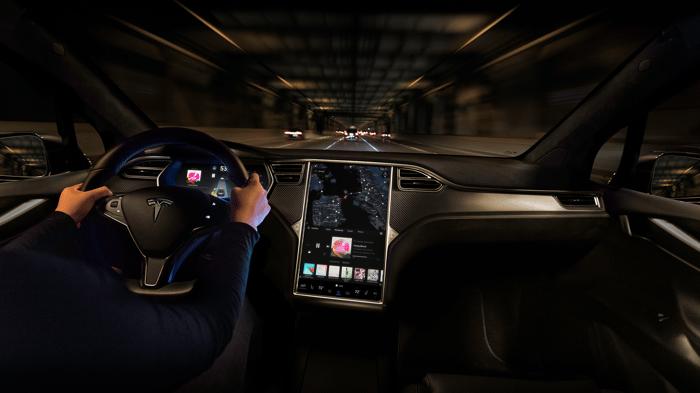 Customer streaming music in a Tesla Model X.
