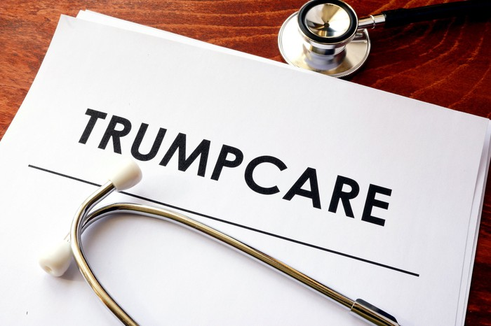 A Trumpcare plan lying next to a stethoscope.