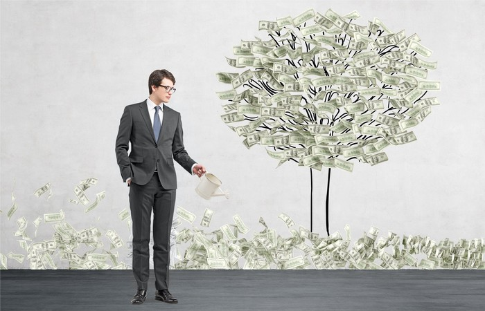 "A man ""growing"" a money tree."