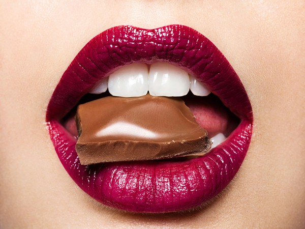 Getty Chocolate in Womans Lips