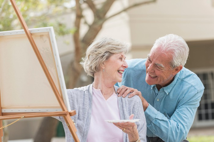 Retired couple working on a painting