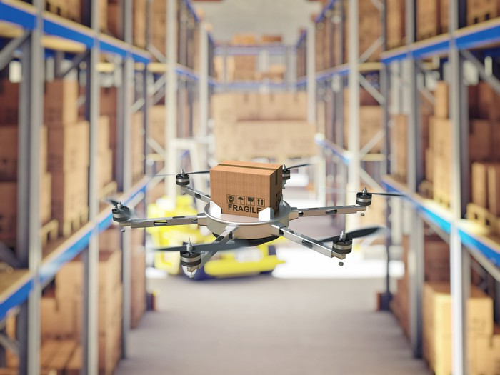 Rendering of a drone flying through a warehouse delivering packages.
