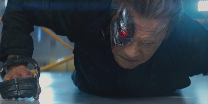 Arnold Schwarzenegger as the Terminator getting back up.