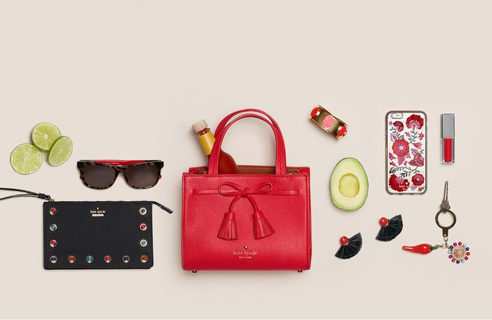 A Kate Spade web ad, featuring a purse, sunglasses, and several other accessories.