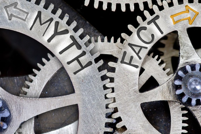 """Two cogs in a machine. One is labeled """"myth,"""" the other is labeled """"fact."""""""