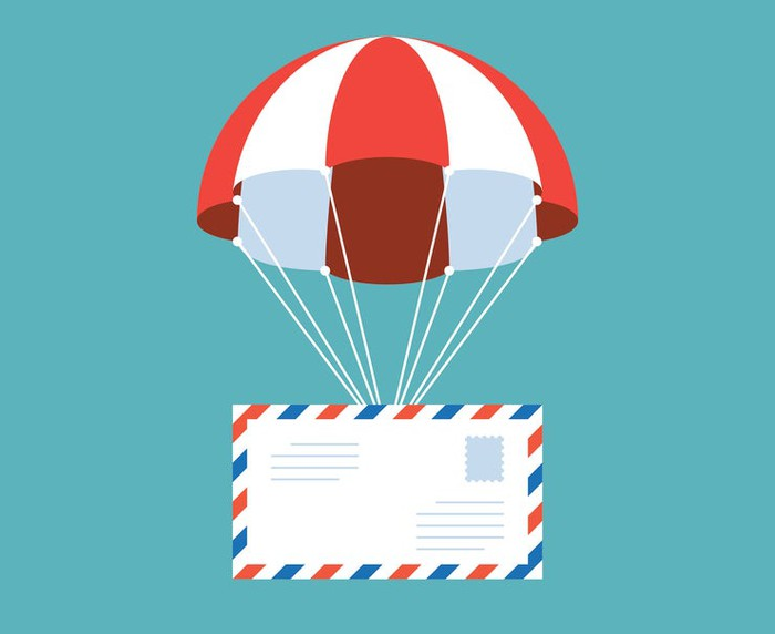 International air mail envelope hoisted by red-striped parachute.
