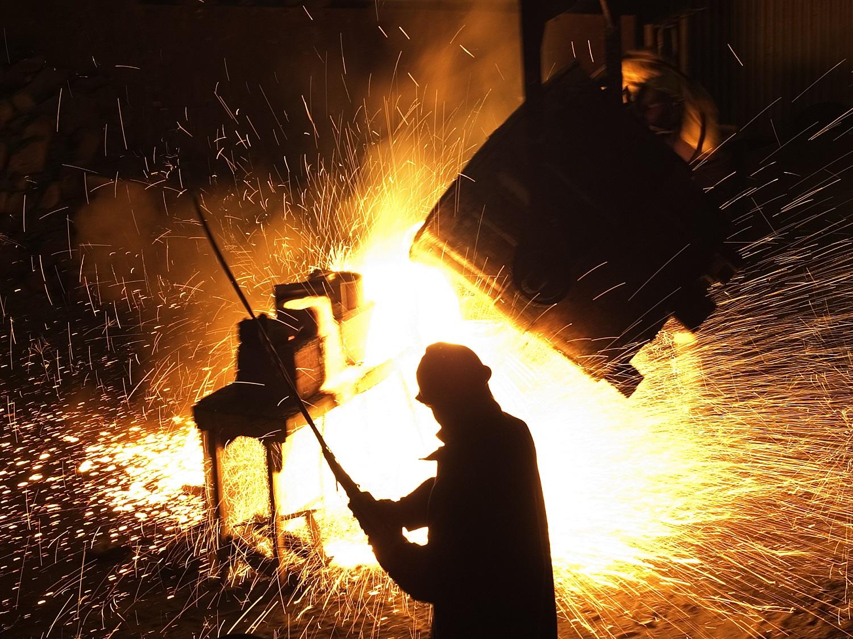 Steel worker in foundry.