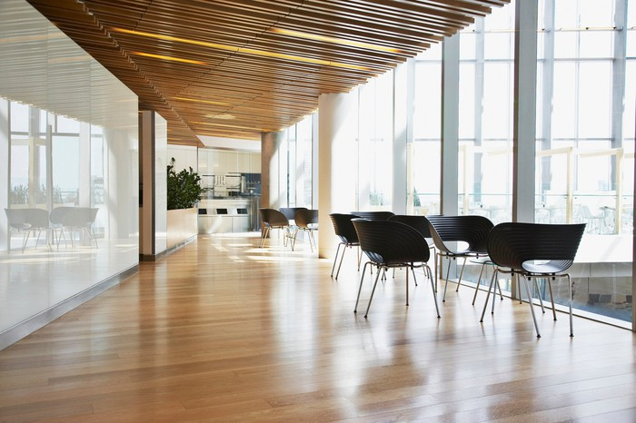 A sleek office hallway with contemporary tables and chairs.