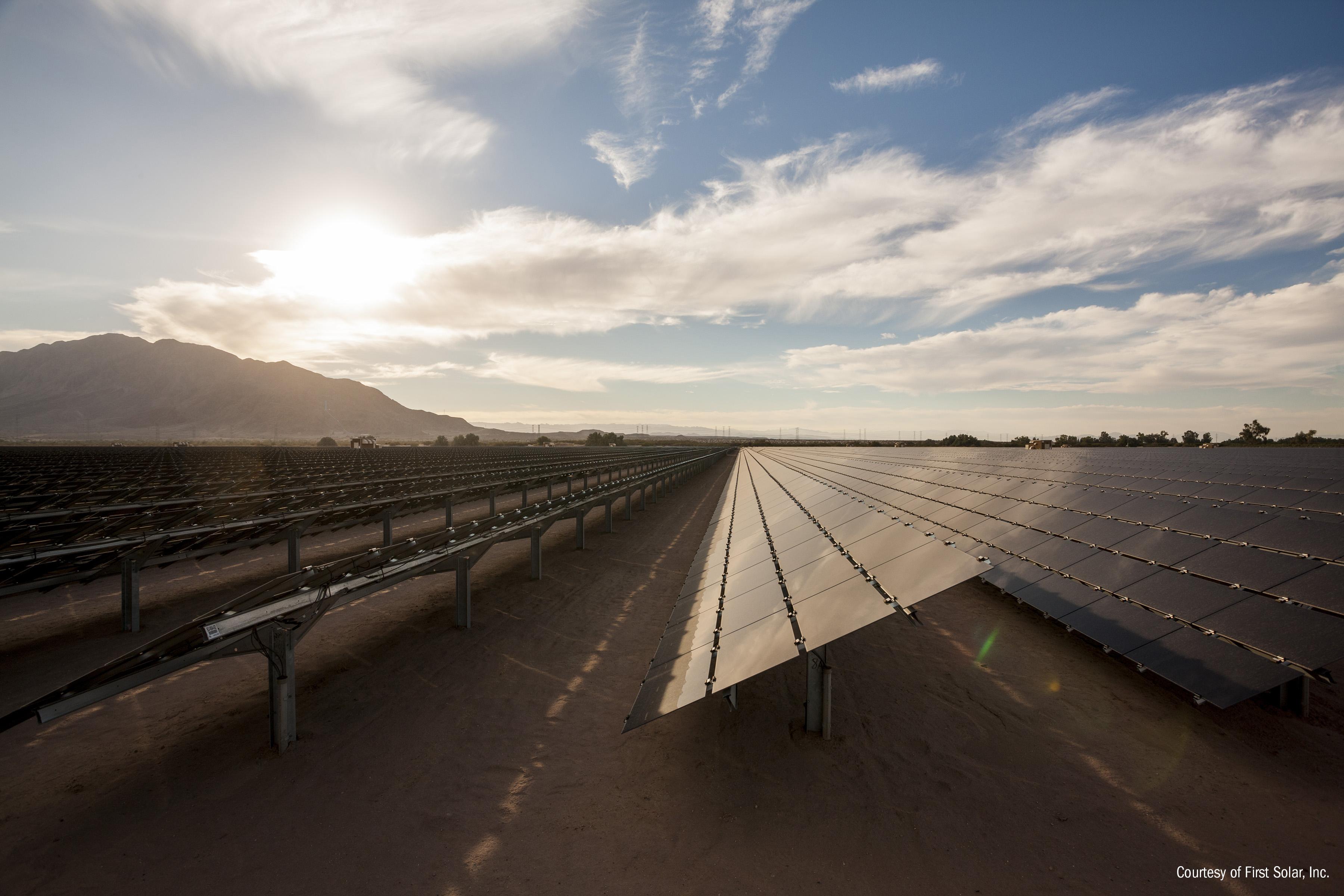 Utility-scale solar farm on a cloudy day.