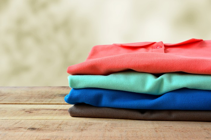 A stack of polo shirts