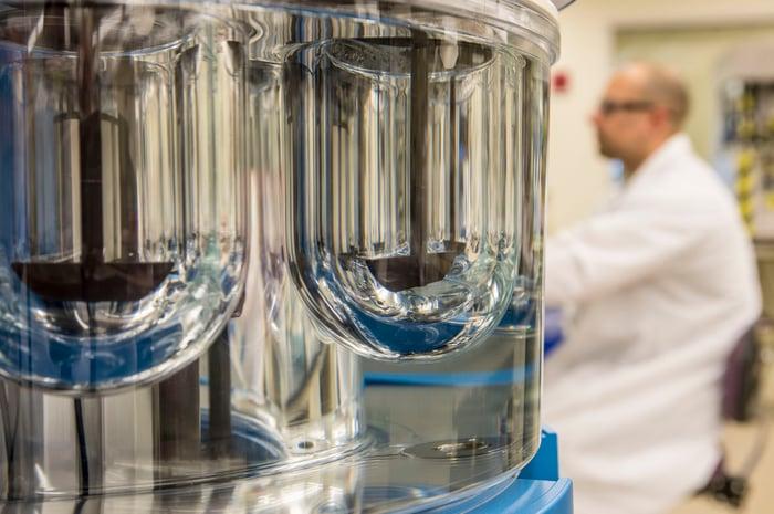 A Vertex scientist working in a lab.