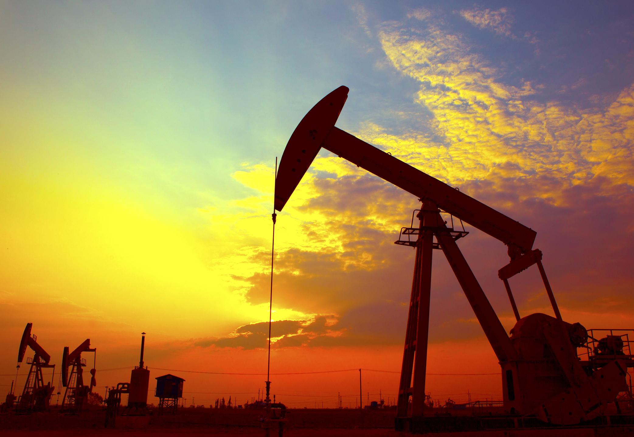 An oil derrick at sunset.
