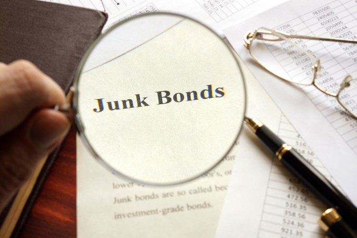 """The words """"junk bonds"""" under a magnifying glass"""