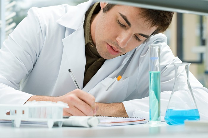 A biotech lab tech conducting research.