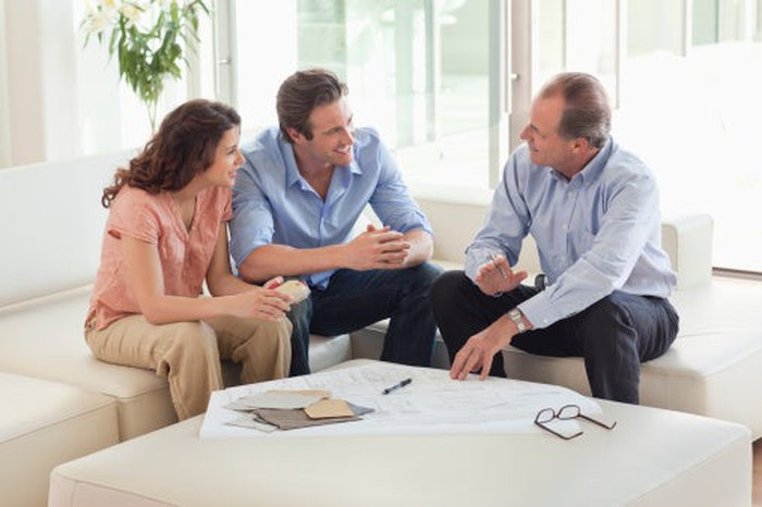 Picture of a couple meeting with a financial advisor.