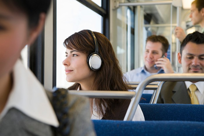Woman with headphones, commuting