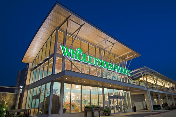 Whole Foods store entrance at night.