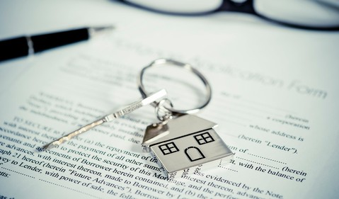Mortgage document with key