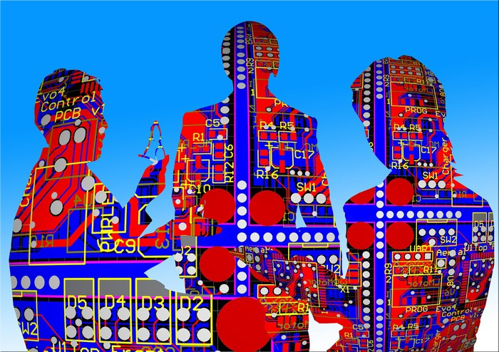 Three human silhouettes overlaid with circuit board images.