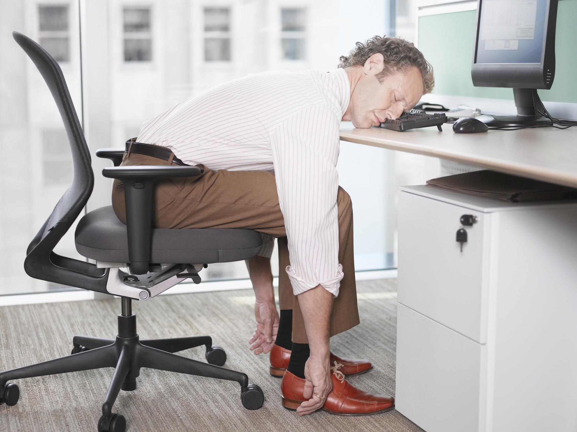 Businessman sleeping at his keyboard