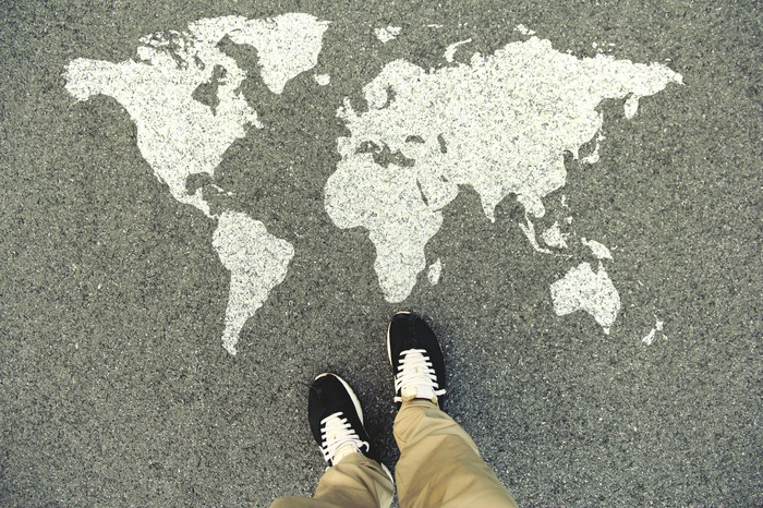World map on asphalt.