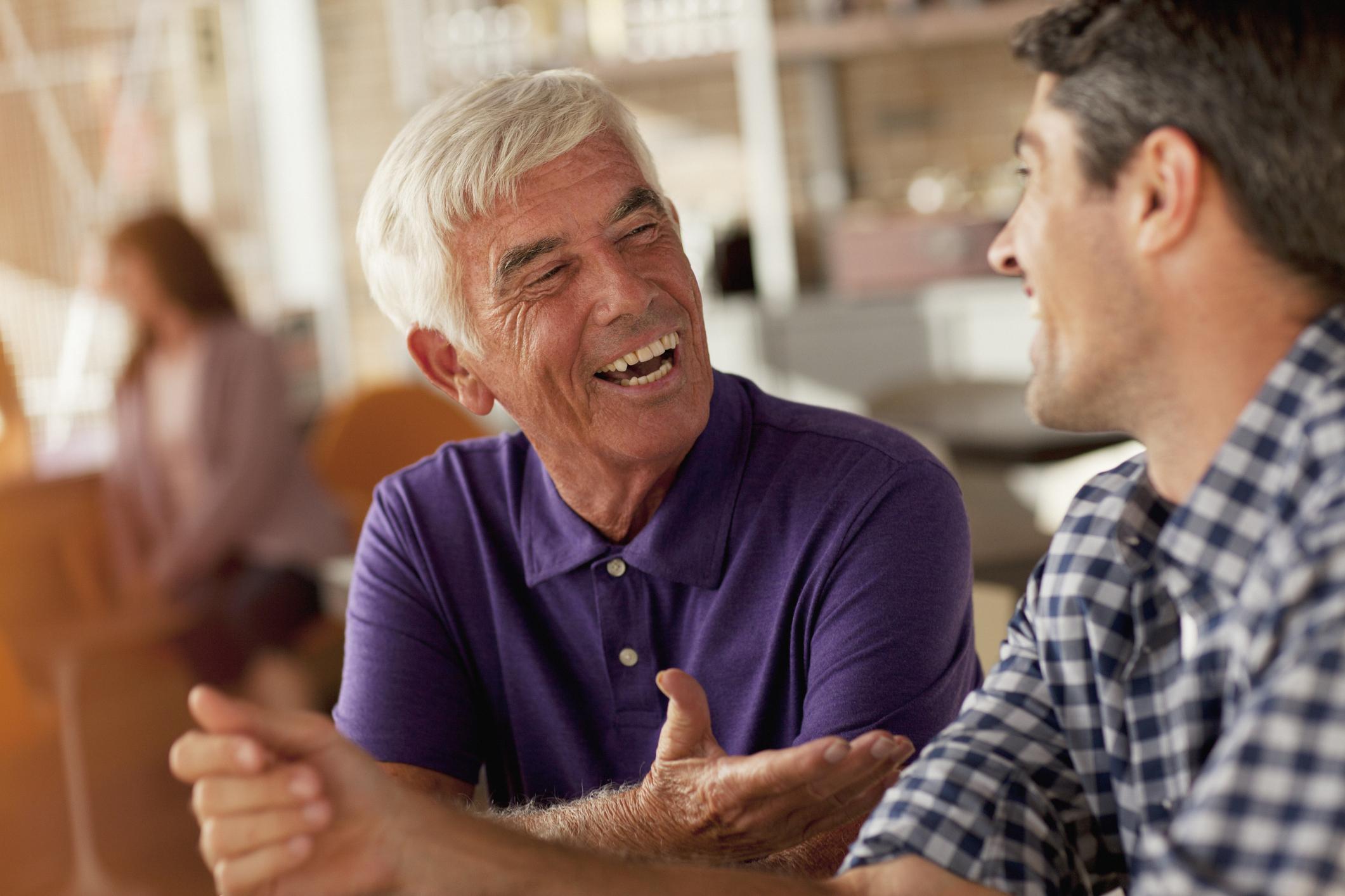 Senior men talking and laughing