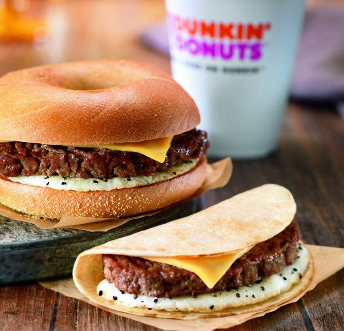 Two Dunkin' Donuts steak sandwiches