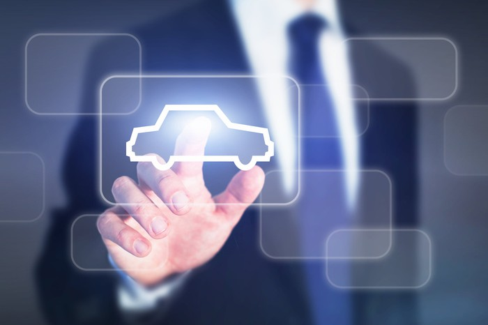 Male pointing to digital representation of one-button car buying