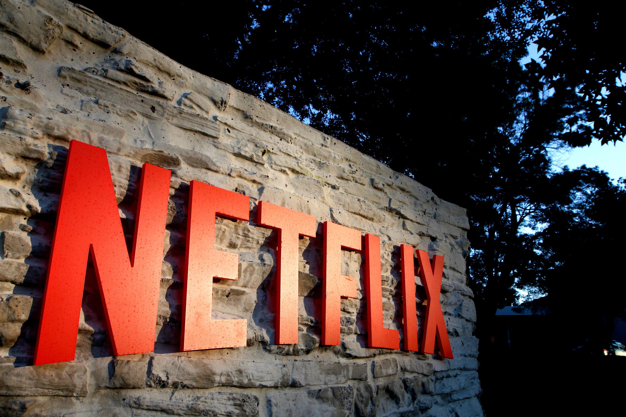 Netflix logo on wall outside company headquarters.