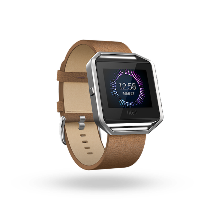 Fitbit smart watch with leather band.