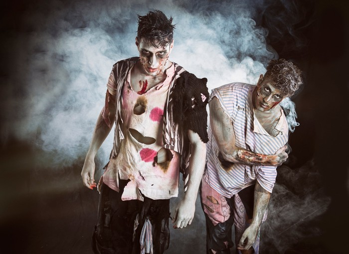 Two zombies give menacing looks.